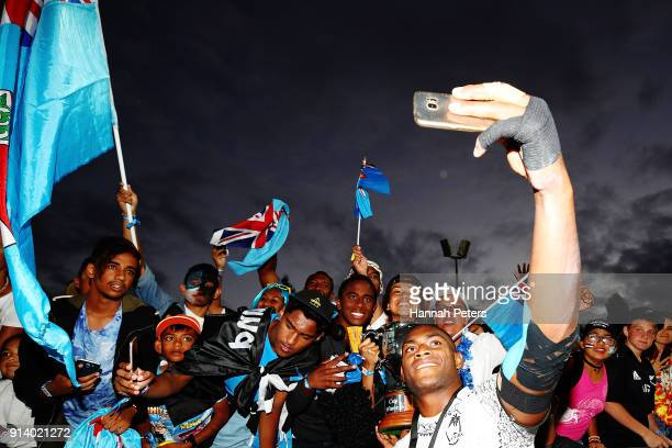 Mesulame Kunavula of Fiji celebrates with fans after winning the Cup final match between Fiji and South Africa the 2018 New Zealand Sevens at FMG...