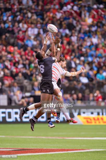 Mesulame Kunavula Vatemo Ravouvou of Fiji and Dan Bibby of England jump for the ball during day 2 of the 2017 Canada Sevens Rugby Tournament on March...