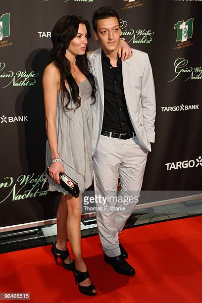 Mesut Oezil and his girlfriend Anna Maria Lagerblom pose during the Werder Bremen Green White Night 2010 at the Congress Centre on February 6 2010 in...