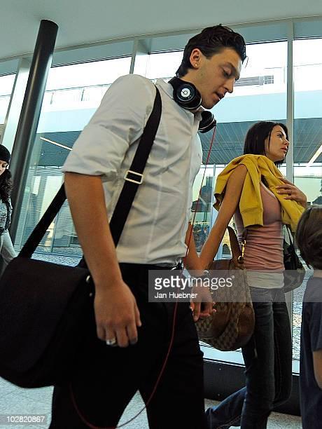 Mesut Oezil and his girlfriend AnnaMaria Lagerblom walking through the terminal between the german national team arrival on July 12 2010 in Frankfurt...