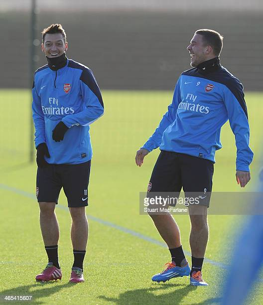 Mesut Oezil and Lukas Podolski of Arsenal during a training session at London Colney on January 27 2014 in St Albans England