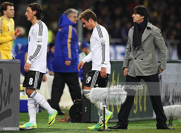 Mesut Oezil and Mario Goetze of Germany are seen after their substitution with head coach Joachim Loew during the International Friendly match...