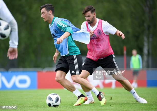 Mesut Oezil and Marvin Plattenhardt of Germany compete for the ball during the Germany training session ahead of the 2018 FIFA World Cup at CSKA...