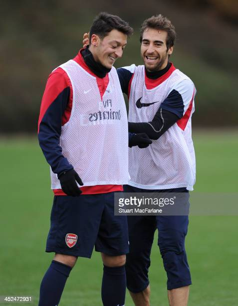 Mesut Oezil and Mathieu Flamini of Arsenal during a training session at London Colney on November 29, 2013 in St Albans, England.