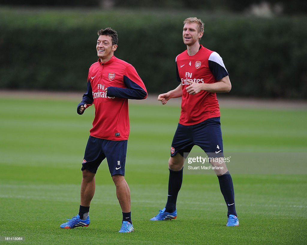 Mesut Oezil and Per Mertesacker of Arsenal during a training session at London Colney on September 21, 2013 in St Albans, England.