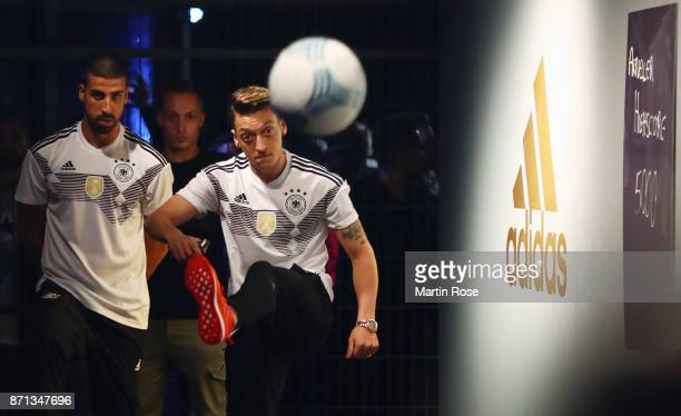 Mesut Oezil and Sami Khedira attend the presentation of the new adidas Germany kit for the 2018 FIFA World Cup Russia at The Base on November 7 2017...