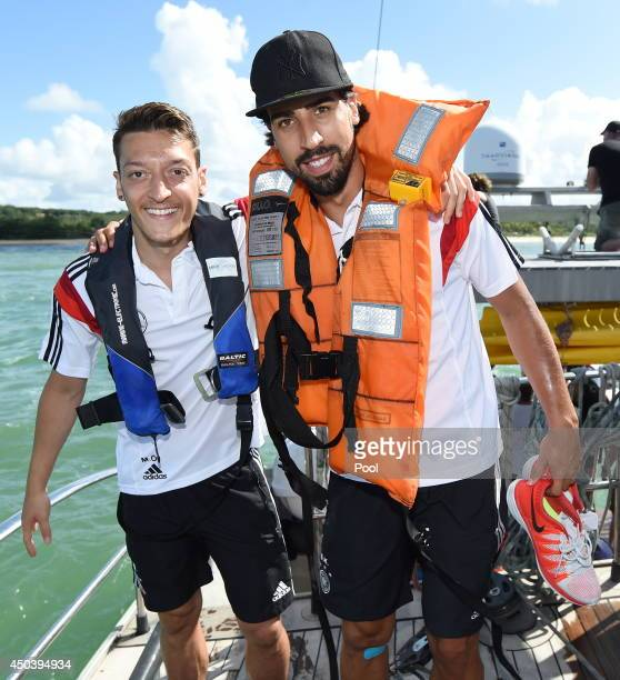 Mesut Oezil and Sami Khedira of the German National team enjoy a sailing trip with Mike Horn at Campo Bahia on June 10 2014 in Santo Andre Brazil