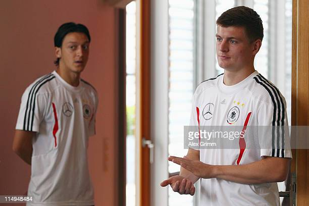 Mesut Oezil and Toni Kroos of Germany wait for a press conference ahead of their UEFA EURO 2012 qualifying match against Austria on May 31 2011 in...