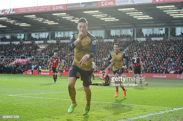 Mesut Oezil celebrates scoring the first Arsenal goal during the Barclays Premier League match between AFC Bournemouth and Arsenal at The Vitality...