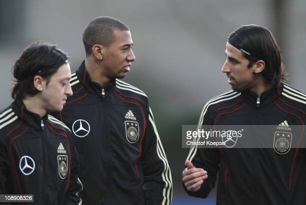 Mesut Oezil Jerome Boateng and Sami Khedria attend the DFB training session at the training ground of the Sporting school Kaiserau on February 8 2011...