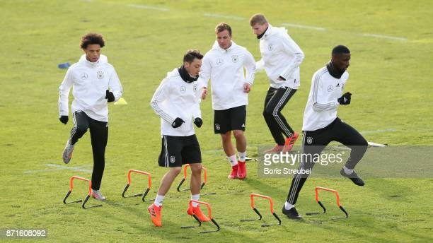 Mesut Oezil Mario Goetze Leroy Sane Timo Werner and Antonio Ruediger of Germany practice during a training session of the German National team at...