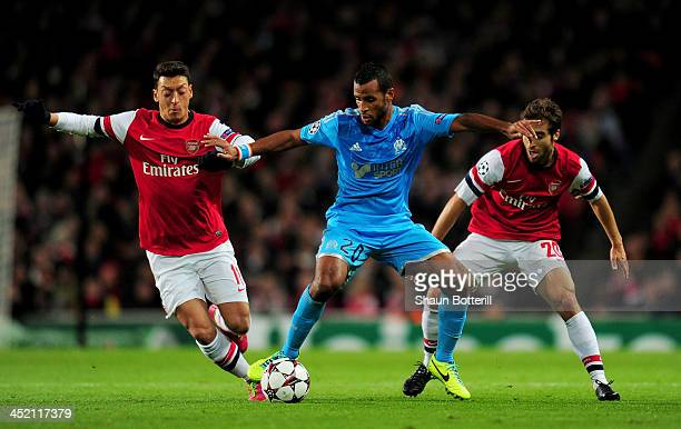 Mesut Oezil of Arsenal and Alaixys Romao of Marseille battle for the ball during the UEFA Champions League Group F match between Arsenal and...