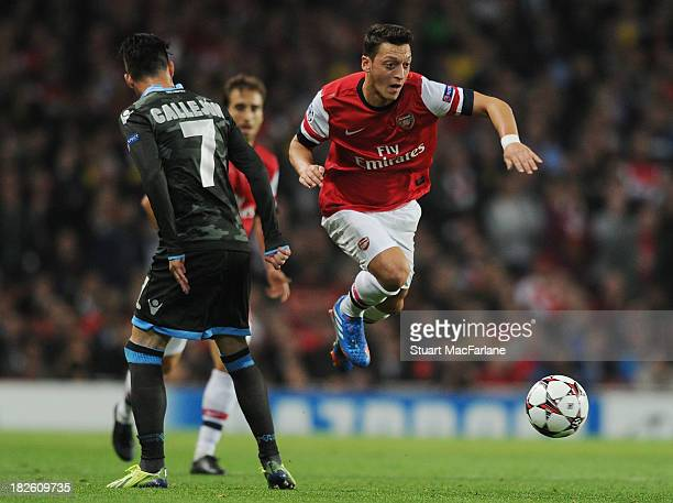 Mesut Oezil of Arsenal breaks past Jose Callejon of Napoli during the UEFA Champions League Group F match between Arsenal FC and SSC Napoli at...