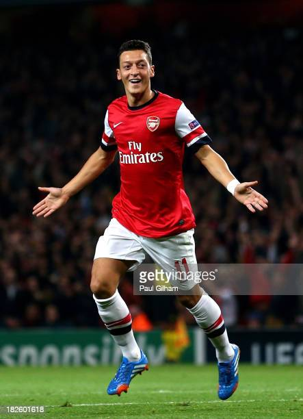 Mesut Oezil of Arsenal celebrates after scoring the opening goal during UEFA Champions League Group F match between Arsenal FC and SSC Napoli at...