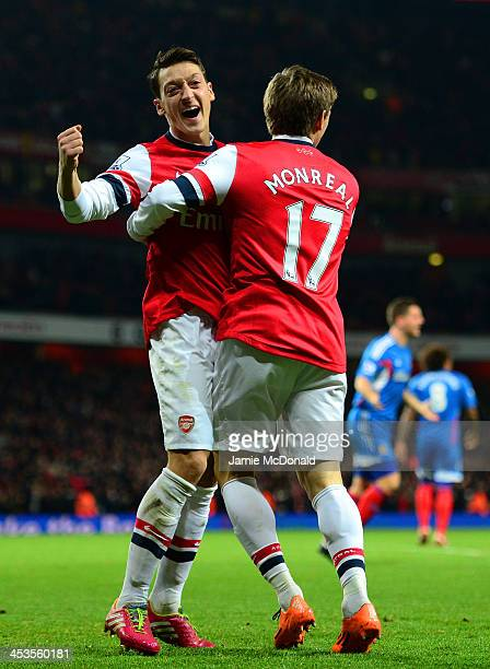 Mesut Oezil of Arsenal celebrates his goal with Nacho Monreal of Arsenal during the Barclays Premier League match between Arsenal and Hull City at...