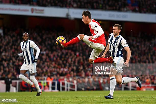 Mesut Oezil of Arsenal controls the ball during the Premier League match between Arsenal and West Bromwich Albion at Emirates Stadium on December 26...