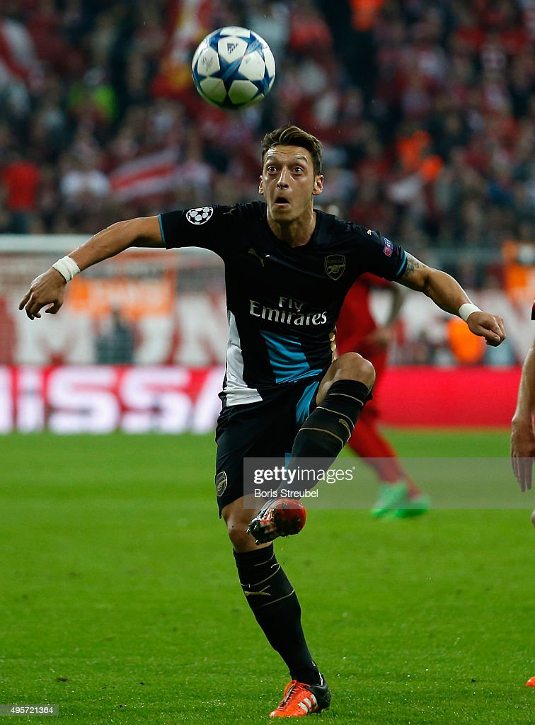Mesut Oezil of Arsenal controls the ball during the UEFA Champions League Group F match between FC Bayern Muenchen and Arsenal FC at Allianz Arena on November 4, 2015 in Munich, Germany.