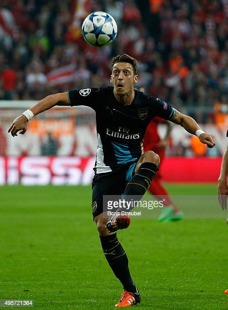 Mesut Oezil of Arsenal controls the ball during the UEFA Champions League Group F match between FC Bayern Muenchen and Arsenal FC at Allianz Arena on...