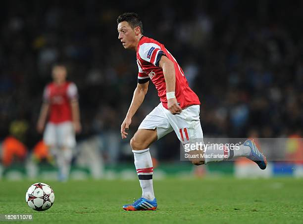 Mesut Oezil of Arsenal during the UEFA Champions League Group F match between Arsenal FC and SSC Napoli at Emirates Stadium on October 1 2013 in...
