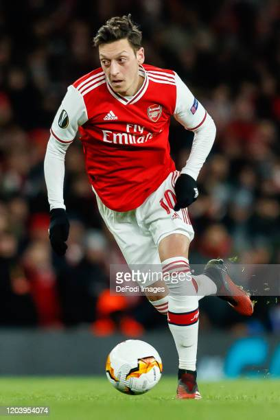 Mesut Oezil of Arsenal FC controls the ball during the UEFA Europa League round of 32 second leg match between Arsenal FC and Olympiacos FC at...