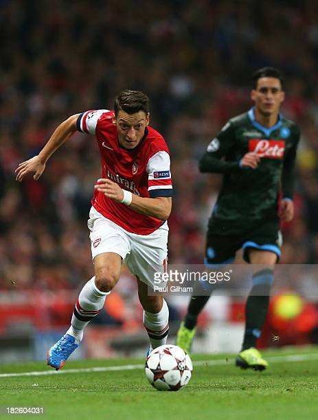 Mesut Oezil of Arsenal goes past Lorenzo Insigne of Napoli during UEFA Champions League Group F match between Arsenal FC and SSC Napoli at Emirates...