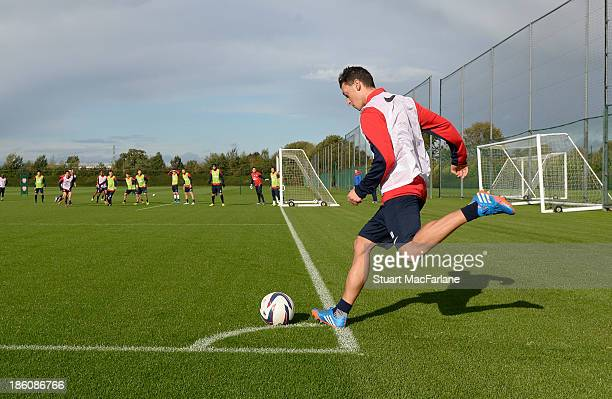 Mesut Oezil of Arsenal in action during a training session at London Colney on October 28 2013 in St Albans England