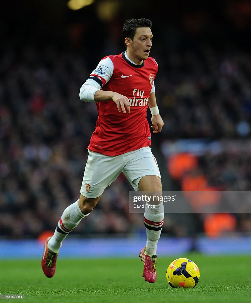 Mesut Oezil of Arsenal in action during the match between Arsenal and Fulham in the Barclays Premier League at Emirates Stadium on January 18, 2014 in London, England.