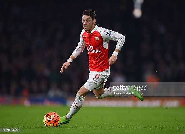 Mesut Oezil of Arsenal runs with the ball during the Barclays Premier League match between Arsenal and Chelsea at Emirates Stadium on January 24 2016...