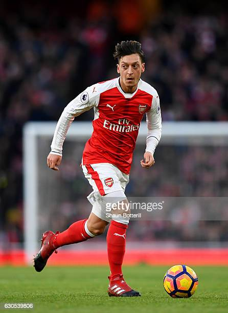 Mesut Oezil of Arsenal runs with the ball during the Premier League match between Arsenal and West Bromwich Albion at Emirates Stadium on December 26...