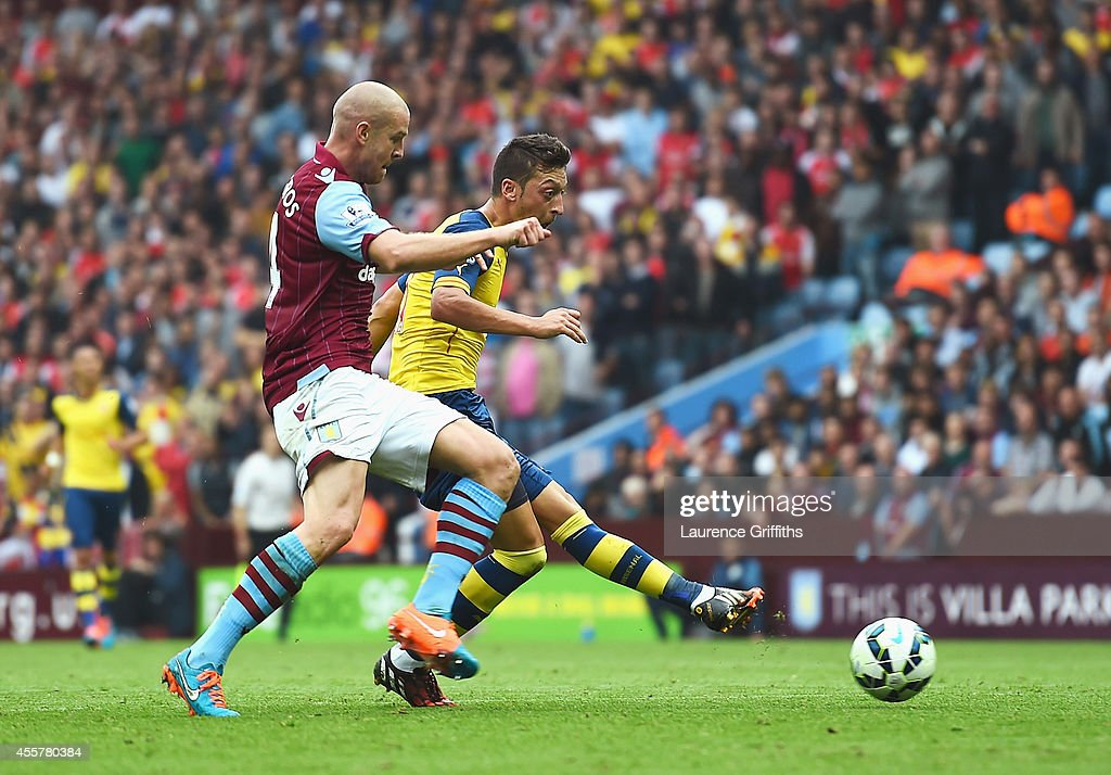 Mesut Oezil of Arsenal scores the opening goal during the Barclays Premier League match between Aston Villa and Arsenal at Villa Park on September 20, 2014 in Birmingham, England.