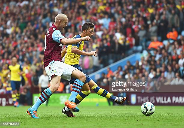 Mesut Oezil of Arsenal scores the opening goal during the Barclays Premier League match between Aston Villa and Arsenal at Villa Park on September 20...