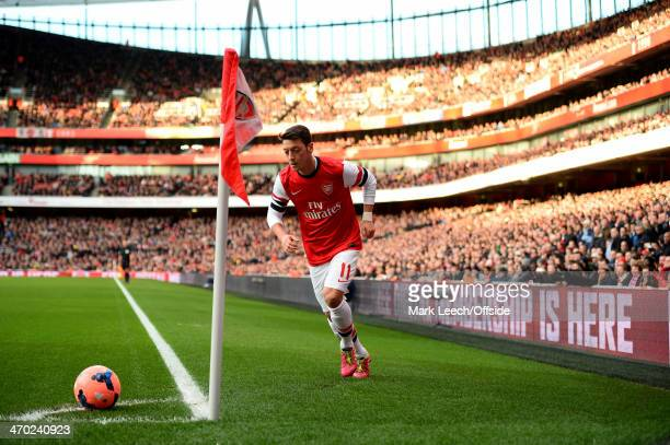 Mesut Oezil of Arsenal takes a corner kick during the FA Cup Fifth Round match between Arsenal and Liverpool at Emirates Stadium on February 16 2014...