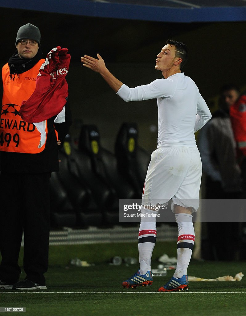 Mesut Oezil of Arsenal throws his shirt and blows a kiss to the Arsenal fans the UEFA Champions League Group F match between Borussia Dortmund and Arsenal at Signal Iduna Park on November 6, 2013 in Dortmund, Germany.
