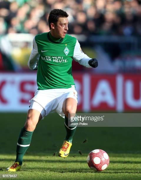 Mesut Oezil of Bremen plays the ball during the Bundesliga match between Werder Bremen and VfB Stuttgart at Weser Stadium on March 6 2010 in Bremen...
