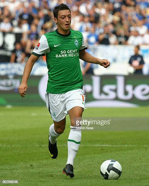 Mesut Oezil of Bremen runs with the ball during the Bundesliga match between Hertha BSC Berlin and SV Werder Bremen at the Olympic stadium on August...