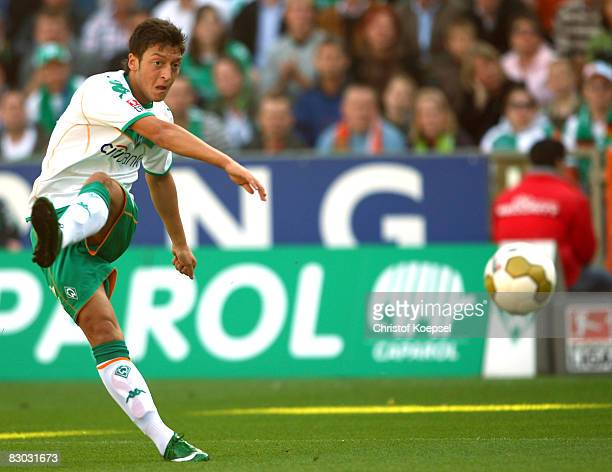 Mesut Oezil of Bremen scores the first goal during the Bundesliga match between Werder Bremen and 1899 Hoffenheim at the Weser stadium on September...