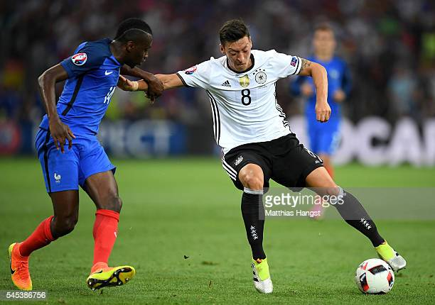 Mesut Oezil of Germany and Blaise Matuidi of France compete for the ball during the UEFA EURO semi final match between Germany and France at Stade...