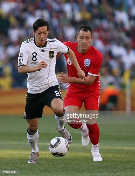 Mesut Oezil of Germany and John Terry of England