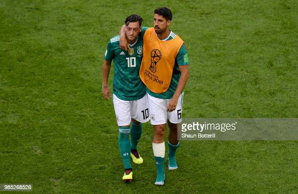 Mesut Oezil of Germany and Sami Khedira of Germany look dejected following their sides defeat in the 2018 FIFA World Cup Russia group F match between...