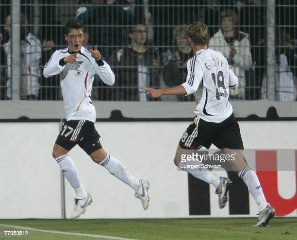 Mesut Oezil of Germany celebrates after scoring during the U21 Euro 2009 qualifier between Germany and Moldova at the Husterhoehe stadium on October...