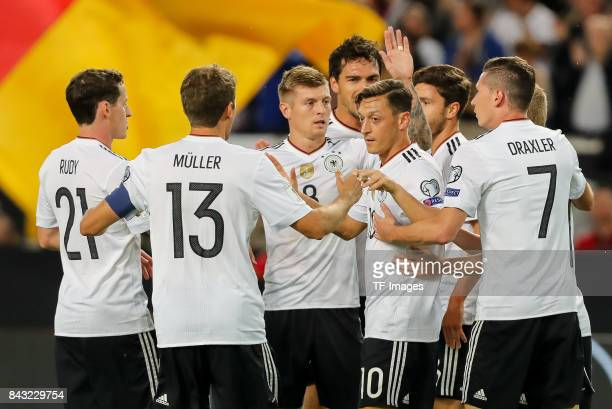 Mesut Oezil of Germany celebrates after scoring his team`s first goal during the FIFA 2018 World Cup Qualifier between Germany and Norway at...