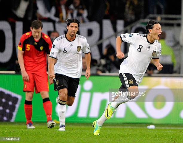 Mesut Oezil of Germany celebrates after scoring his teams opening goal during the Euro 2012 Qualifier Group A match between Germany and Belgium at...