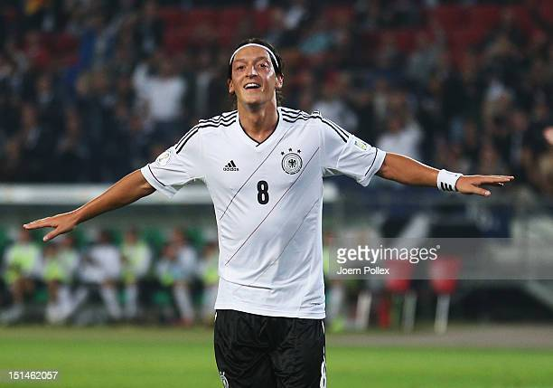 Mesut Oezil of Germany celebrates after scoring his team's second goal the FIFA 2014 World Cup Qualifier group C match between Germany and Faeroe...