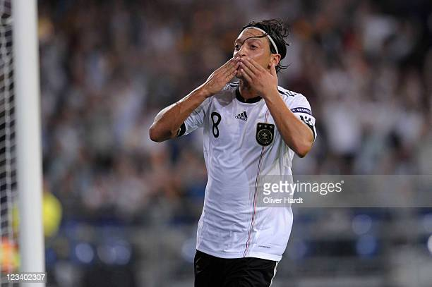 Mesut Oezil of Germany celebrates his second goal during the UEFA EURO 2012 qualifying match between Germany and Austria at VeltinsArena on September...