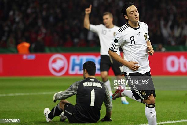 Mesut Oezil of Germany celebrates his team's second goal during the EURO 2012 group A qualifier match between Germany and Turkey at the Olympic...