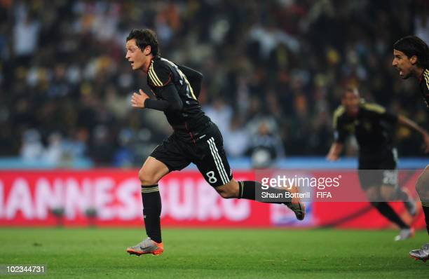 Mesut Oezil of Germany celebrates scoring during the 2010 FIFA World Cup South Africa Group D match between Ghana and Germany at Soccer City Stadium...