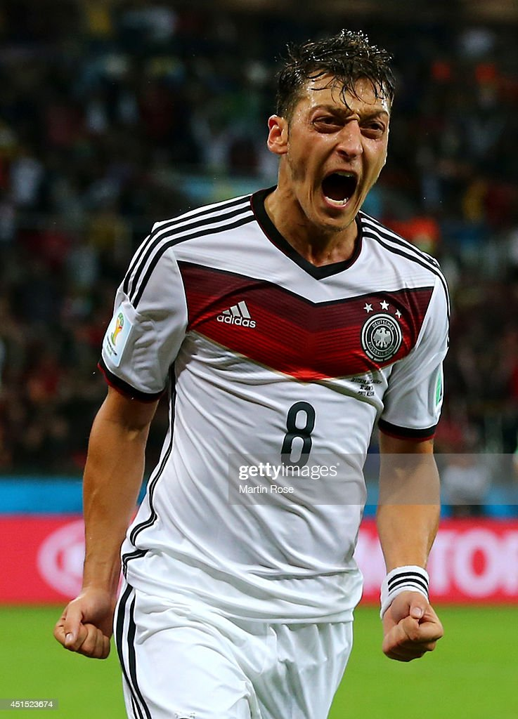 Mesut Oezil of Germany celebrates scoring his team's second goal in extra time during the 2014 FIFA World Cup Brazil Round of 16 match between Germany and Algeria at Estadio Beira-Rio on June 30, 2014 in Porto Alegre, Brazil.