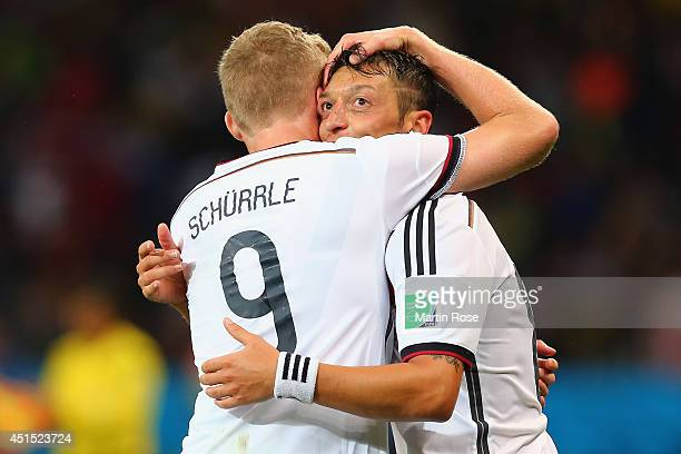 Mesut Oezil of Germany celebrates scoring his team's second goal in extra time with Andre Schuerrle during the 2014 FIFA World Cup Brazil Round of 16...