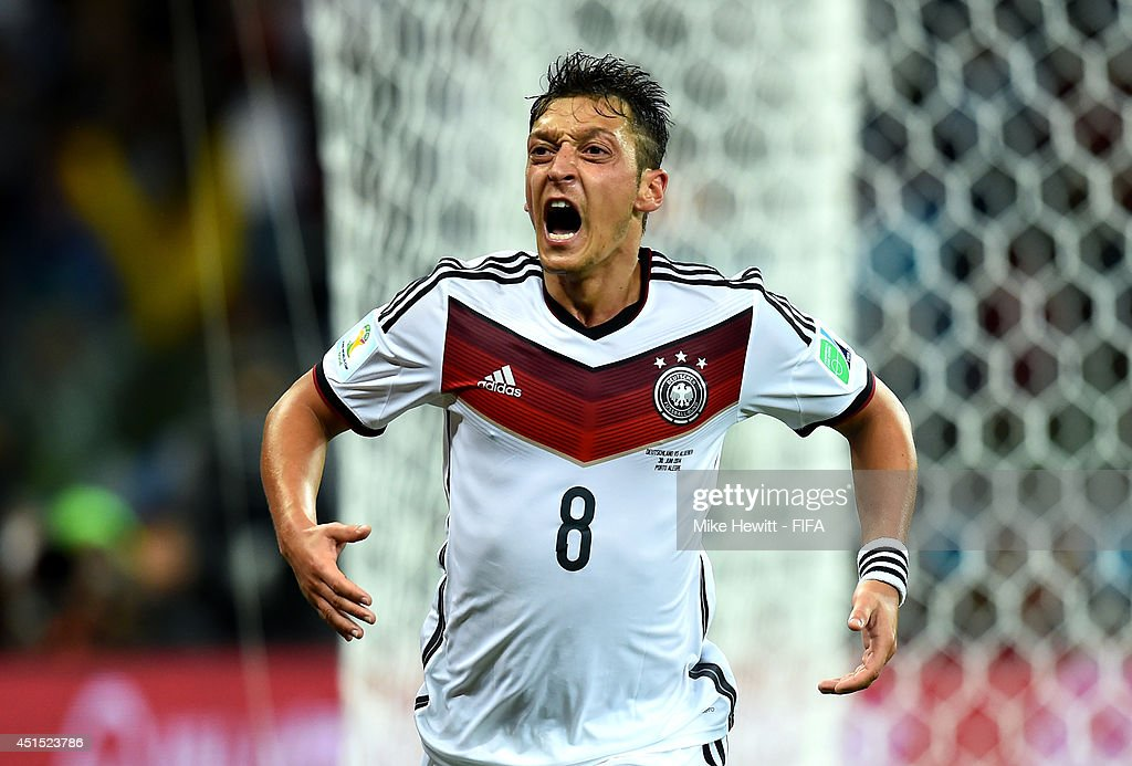 Mesut Oezil of Germany celebrates scoring his team's second goal during the 2014 FIFA World Cup Brazil Round of 16 match between Germany and Algeria at Estadio Beira-Rio on June 30, 2014 in Porto Alegre, Brazil.
