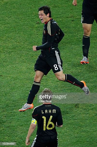 Mesut Oezil of Germany celebrates scoring the opening goal during the 2010 FIFA World Cup South Africa Group D match between Ghana and Germany at...